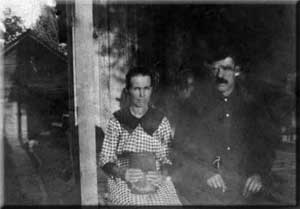 John and Matilda Lawson sitting on the porch at Springhill.